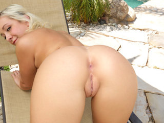 Blonde beauty Cleo Vixen is working on her tan..