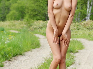 Naughty amateur couple walking naked in nature